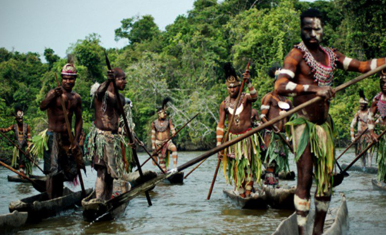 Image of people of Papua New Guinea navigating the Sepik River