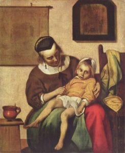 A woman holds he sick child in a pieta like pose. The room around them is full with paintings and other objects.