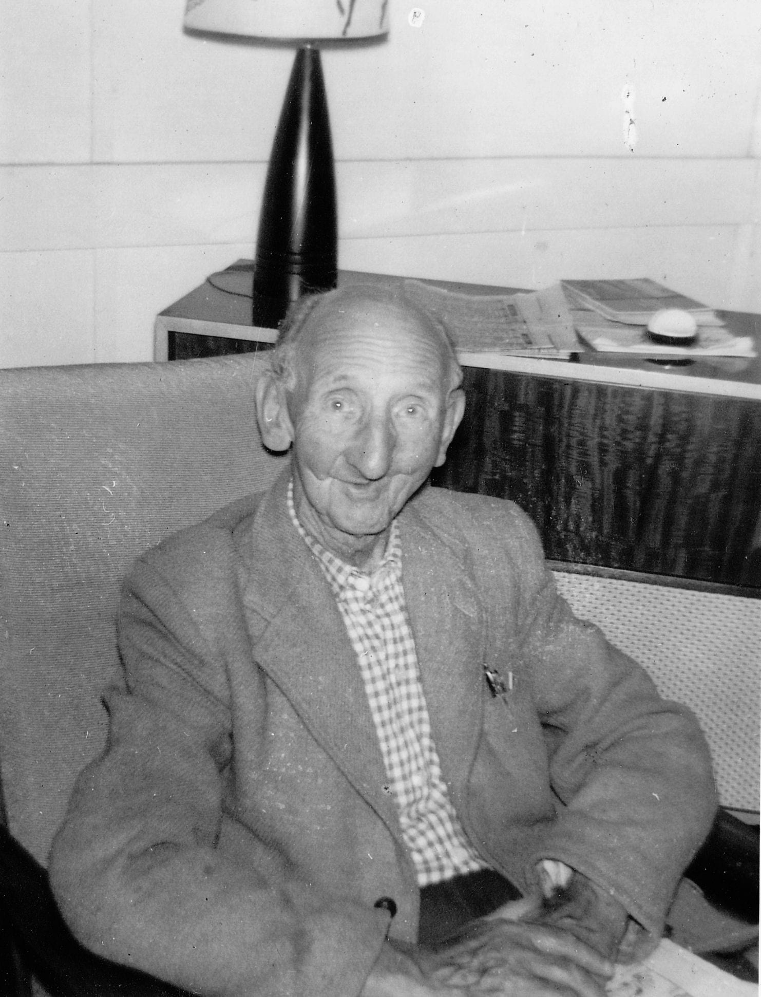 Black and white photograph of a patient many years after recovering and reconstruction from facial injury.