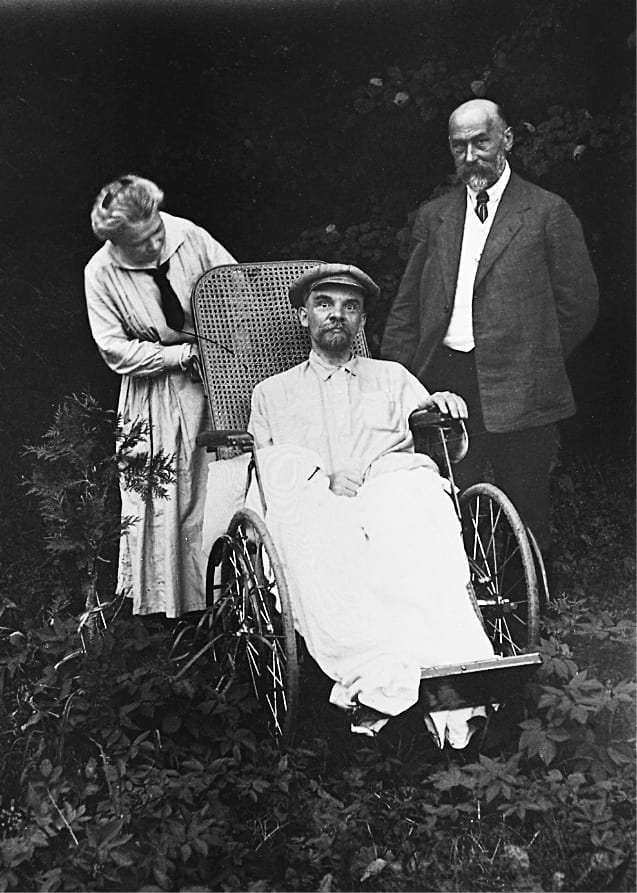 Lenin in a wheelchair attended by a doctor and his sister